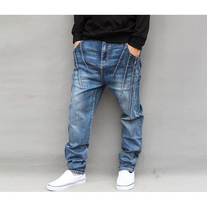 Pantalones harén de los hombres Pantalones harén de mezclilla Goggers de la entrepierna suelta Pantalones largos elásticos de los pantalones vaqueros cónicos más el tamaño L-6XL