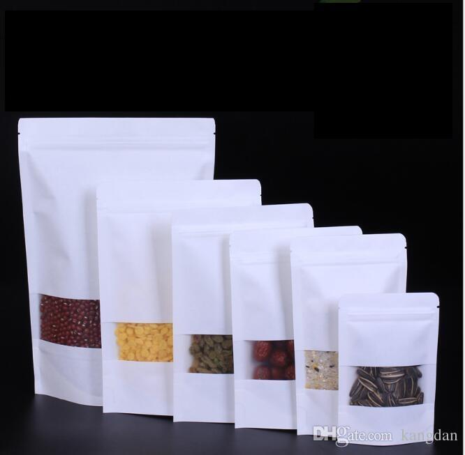 Le borse di carta bianche di Kraft stanno sul sacchetto con la borsa al minuto della finestra Commestibile a prova d'umidità per i fagioli del biscotto dello spuntino Borsa d'imballaggio della caramella
