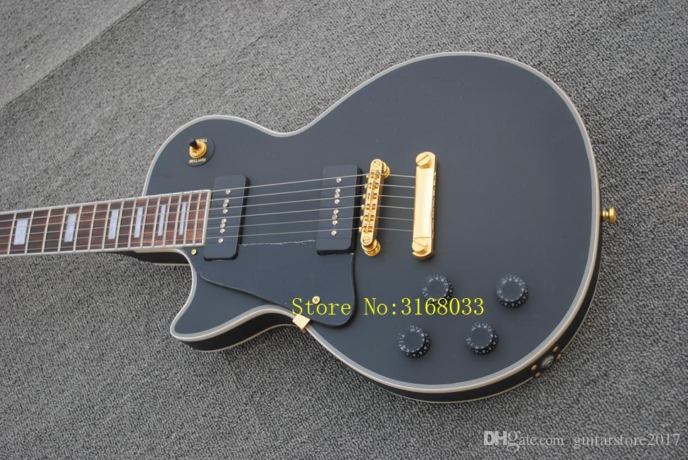 La chitarra della mano sinistra della chitarra elettrica nera solida nera all'ingrosso del nuovo arrivo di arrivo libera il trasporto
