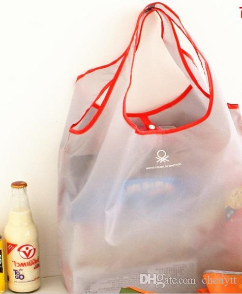 2018 النسخة الكورية من الموضة الجديدة ، الحلوى ، اللون ، قابلة للطي ، وأكياس التسوق سوبر ماركت ، حقائب اليد المحمولة حماية البيئة.