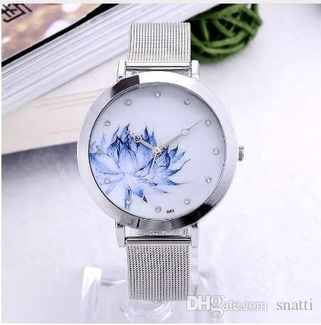 Reloj de las mujeres Reloj Torre Eiffel Reloj de pulsera de cuarzo de la flor Nueva moda Relojes de mariposa de acero inoxidable Elegante Mujer Relojes