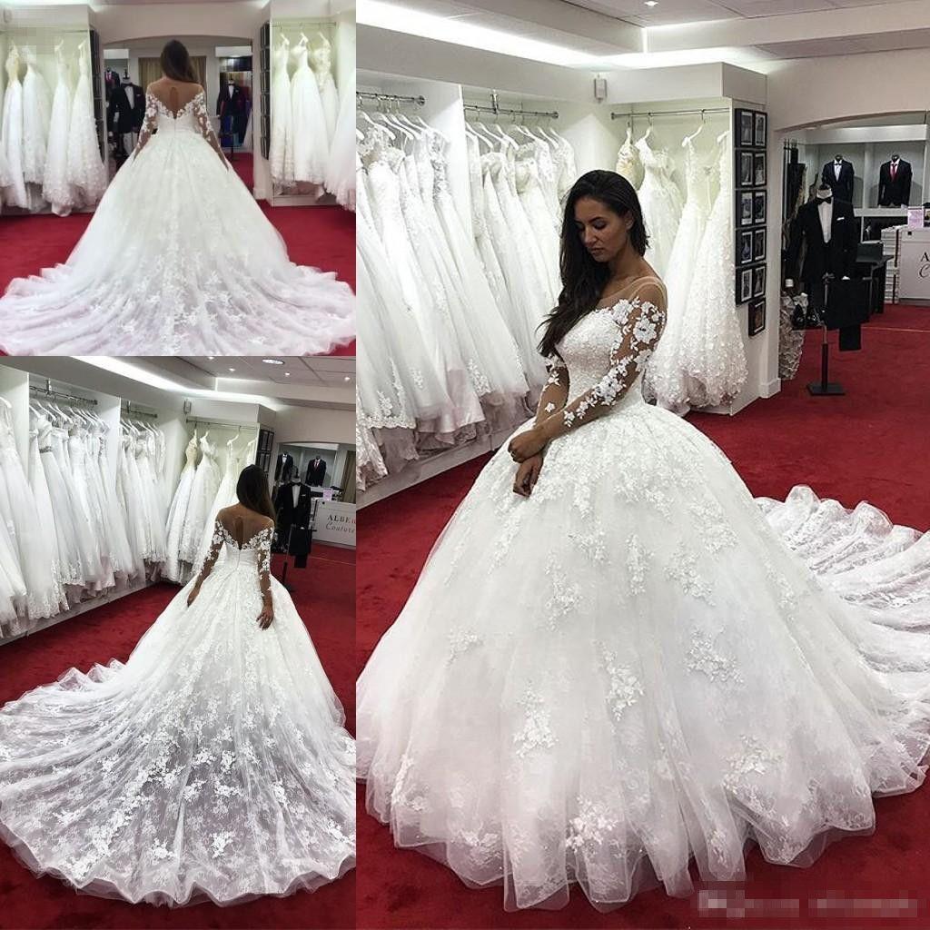 Modest Ball Gown Abiti da sposa maniche lunghe Illusione Indietro Indietro Cappella Treno Pizzo Appliqued Autunno Bridal Bridal Bridal