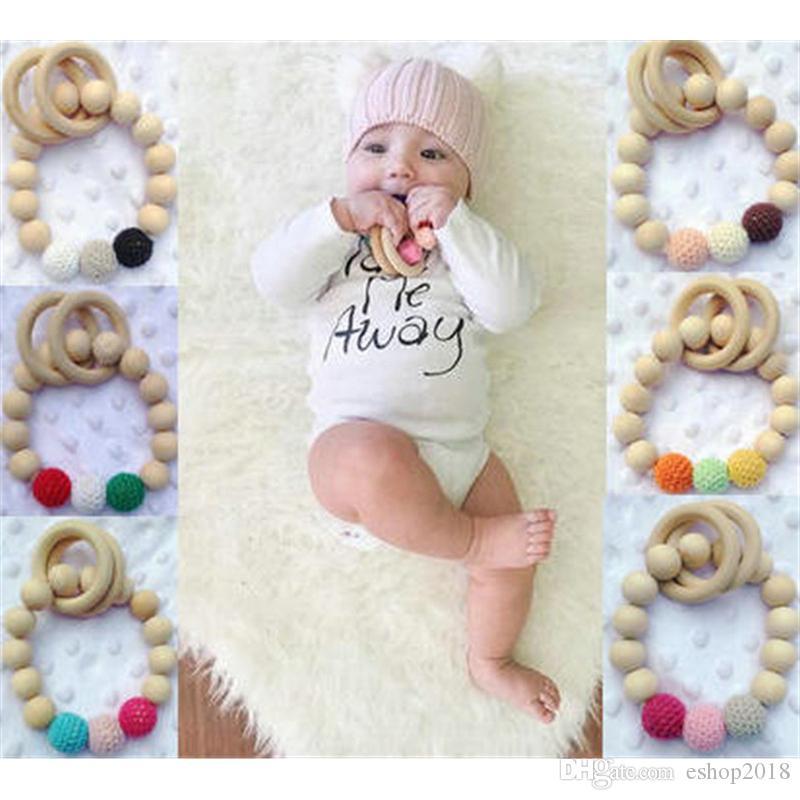 جديد وصول الطراز الأوروبي الأطفال أساور خشبية الطفل عضاضة للأسنان الرضع خشبي الخرز حلقات التسنين الخرز هاندماكي التسنين لعب اطفال ورضيع