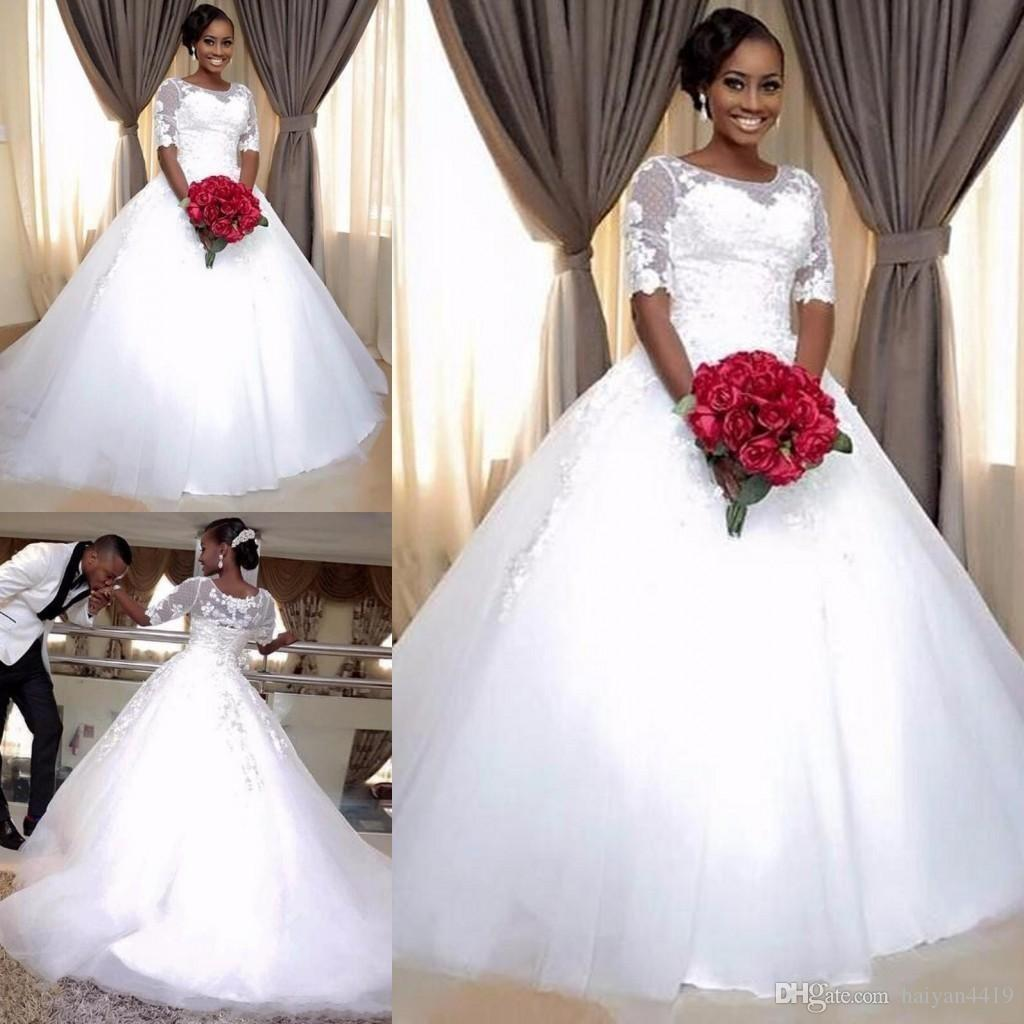 Vintage 2018 African A Line Wedding Dresses Jewel Neck Half Sleeves Illusion Lace Appliques Sweep Train Puffy Custom Formal Bridal Gowns