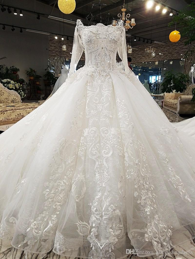 Großhandel 14 Bohemian Luxus Brautkleider Lange Tüll Hülsen Spitze Oben  Zurück Illusion Schatz Ansatz Glänzende Kristall Pailletten Strand