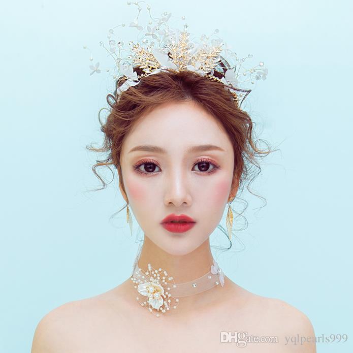 Crown headwear, golden feathers, hair adornment, beautiful brides wedding dress, bridal hoop.