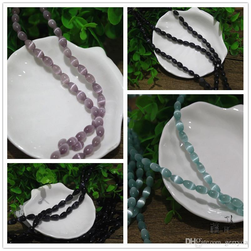 6x9mm cats eye glass rice shape beads,Free shipping!1.2mm hole,factory price!A-Grade material,About 69 pieces per lot