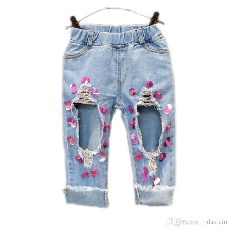 mirada detallada 8237b 64d2e Compre Pantalones Vaqueros Para Bebé 2018 Nuevo Bebé Niña Pantalones  Grandes Agujeros Sólidos Pantalones Vaqueros Lentejuelas Pantalones Rotos  Para ...
