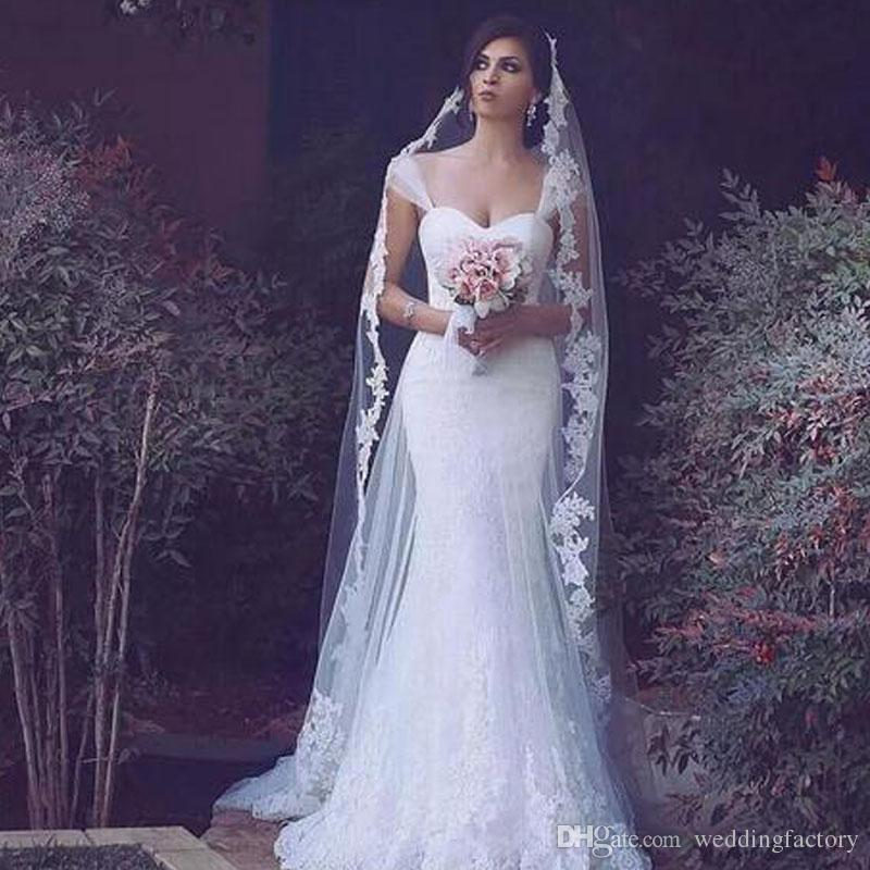 2019 Spring Arabic Mermaid Wedding Dresses Sweetheart Sheer Straps Romantic Lace Appliques Bridal Gowns with Sheer Overskirt High Quality