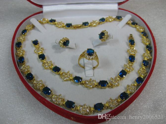 Conjunto de anillo de pulsera con collar de zafiro azul de oro amarillo de 14 k.