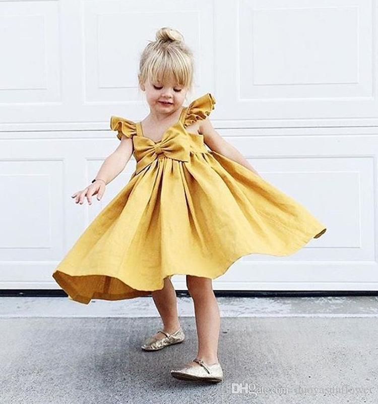 TODDLER BABY GIRLS FLY SLEEVE RUFFLED BOWKNOT BACKLESS SOLID COLOR DRESS