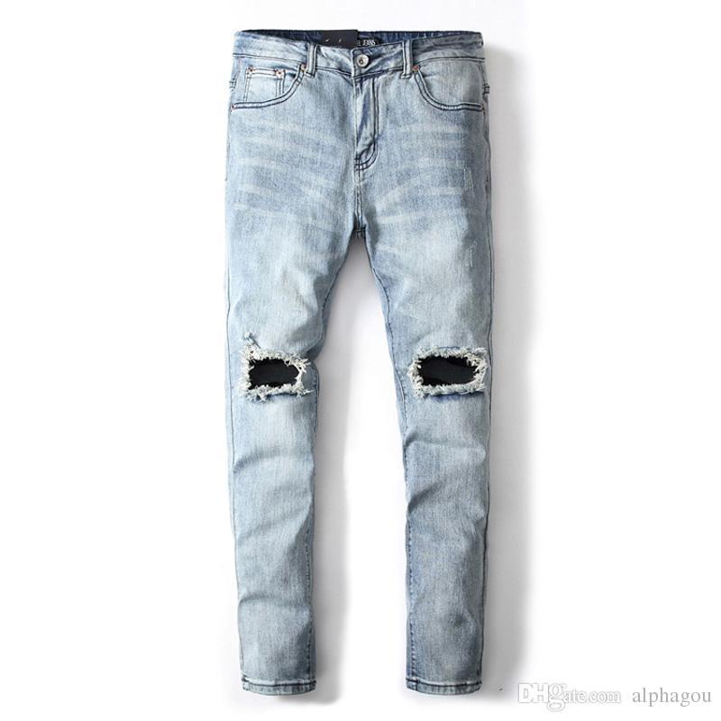 Compre Color Azul Claro Moda Hombres Jeans Pantalones Elasticos Del Dril De Algodon Estilo Punk Destruido Jeans Rotos Homme Brand Men Skinny A 33 02 Del Alphagou Dhgate Com