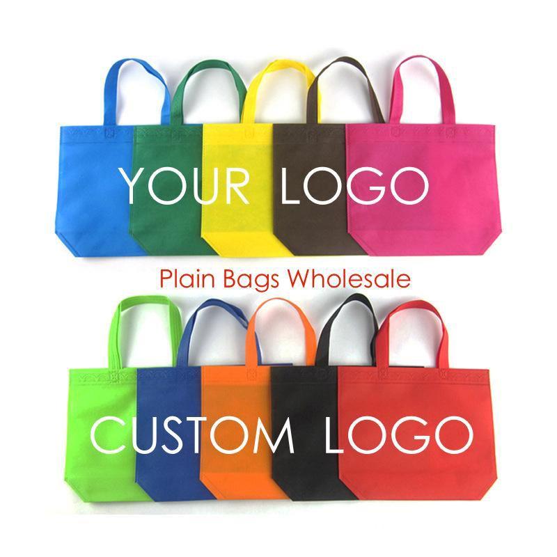 100pcs / lot colore della caramella pianura borsa non tessuta formato regolare 33 * 26 * 10 cm shopping bag logo personalizzato stampa modello personalizzato tote bags all'ingrosso