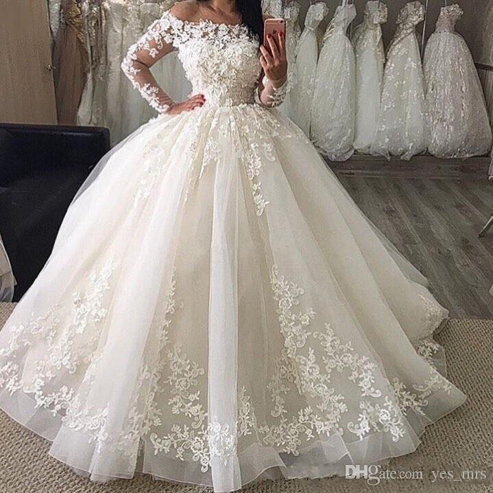 2019 New Puffy Ball Gown Wedding Dresses Off Shoulder Illusion Full Sleeves Lace Appliques Floor Length Organza Plus Size Formal Bridal Gown
