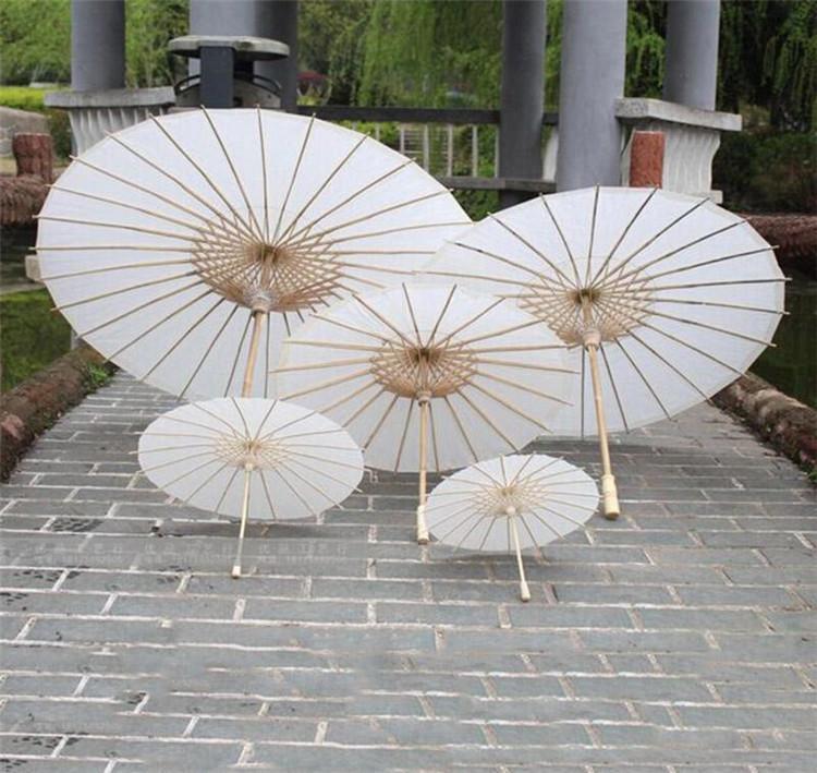 Parasoles de boda nupcial Papel blanco Paraguas Chino Mini Artesanía Paraguas Diámetro 20,30,40,60cm Paraguas de boda 2020