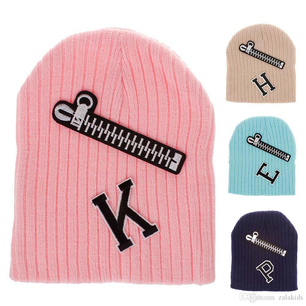 Yeni Çocuklar Erkek Bebek Kız Örgü Şapka Şeker Renk kış sıcak kapaklar Moda Fermuar Mektup Bere Kapaklar 8 renkler