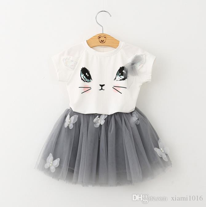 봄 여름 아기 여자 정장 귀여운 고양이 T 셔츠 + 짧은 스커트 어린이 두 조각 아이들의 의류 세트 무료 배송