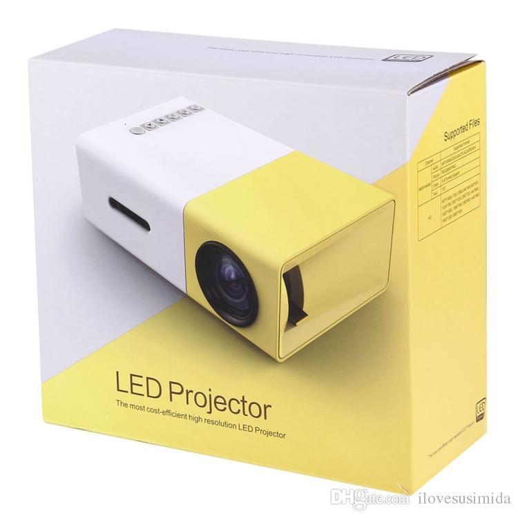Barato YG-300 2M 60 pulgadas 600 lúmenes mini LED Proyector HD Home Theater con 3 en 1 Video Convert Cable Remote Controller