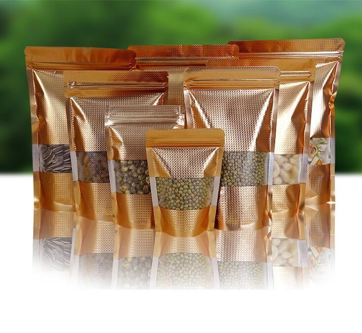 Borse di blocco stand Oro Fino Mylar Zipper con la finestra di alluminio richiudibile alimenti Imballaggio sacchetto di pellicola di sigillo snack caramelle imballaggio sacchi a valvola