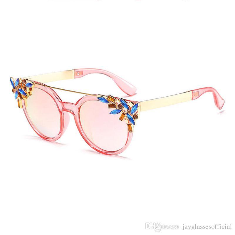 2019 Luxury Diamond Cat Eye Shades Sunglasses Mujeres Diseñador de la marca única Gafas de sol Estilo de moda Gafas de sol UV400 Gafas
