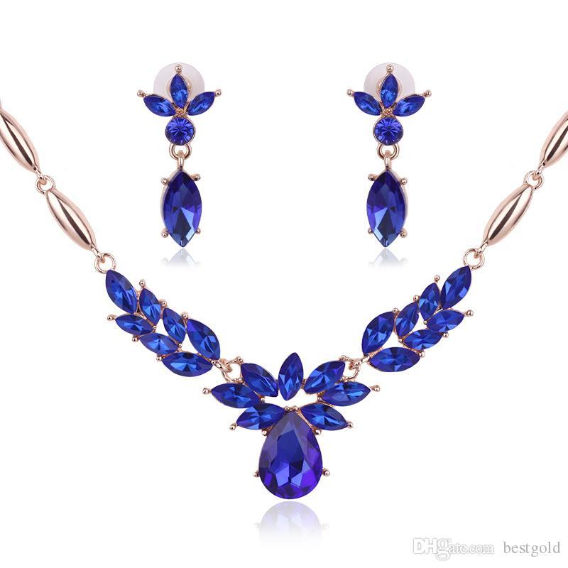 Joyas azules Chapado en oro Conjunto de collares Flores de moda Boda de diamantes Conjuntos de bisutería nupcial Fiesta Joyas de rubíes (Collar + Pendientes)