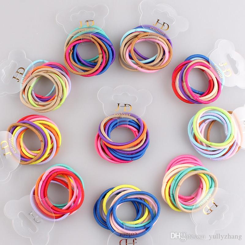 Livraison gratuite 4.5cm Dia 100 PCS Noir / coloré Cravates De Cheveux Simple Style Titulaire Élastique Hirties fille accessoires De Cheveux 100pcs / lot multiple couleur