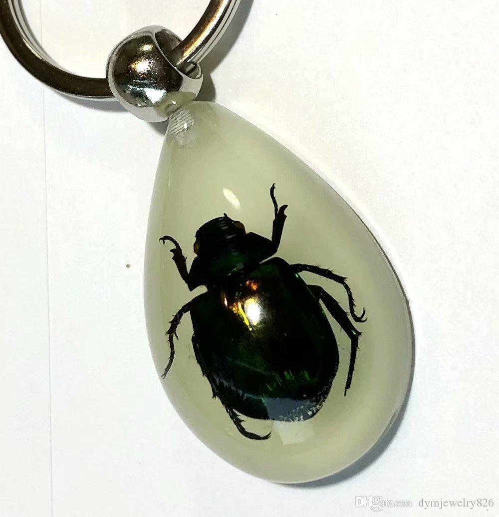 Бесплатная доставка yqtdmy 24 шт. vogue Жук насекомых дизайн светящийся падение прохладный брелок