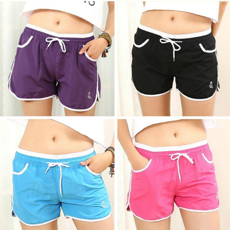 Atacado-2018 nova moda 8 cores Sports Shorts Mulheres Casual Shorts de algodão solto Side Dividir cintura elástica Mulheres Shorts Running
