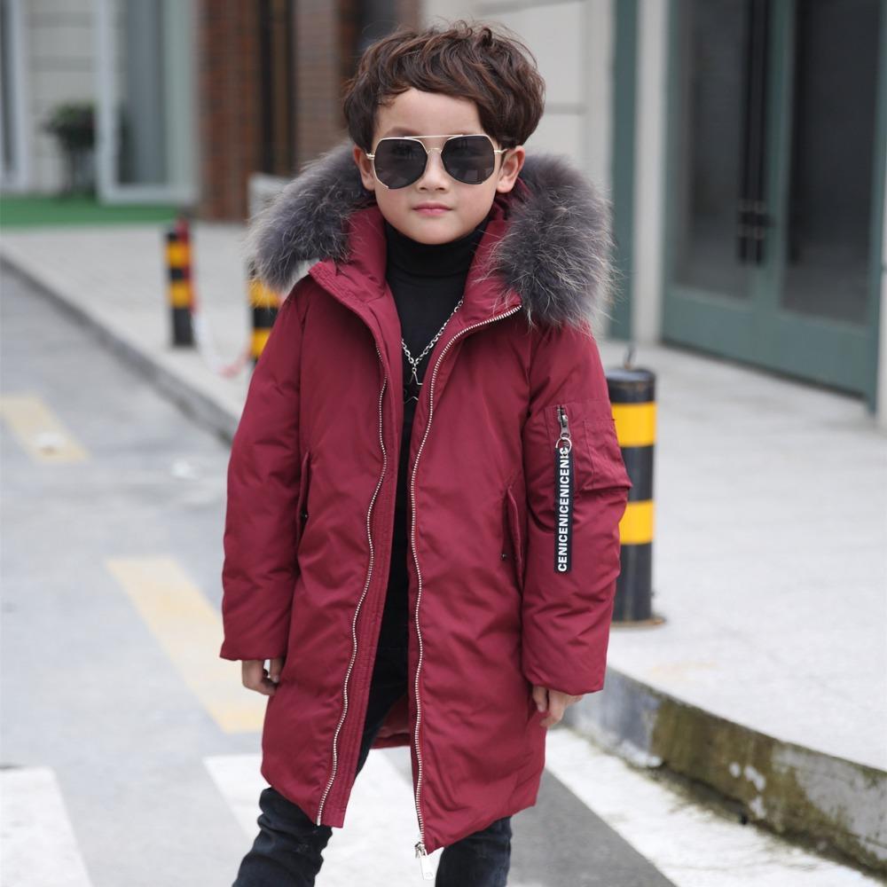 Дети Россия зимние теплые пуховики для мальчиков с длинным сечением утолщение пальто мальчика с меховым воротником с капюшоном -30 градусов