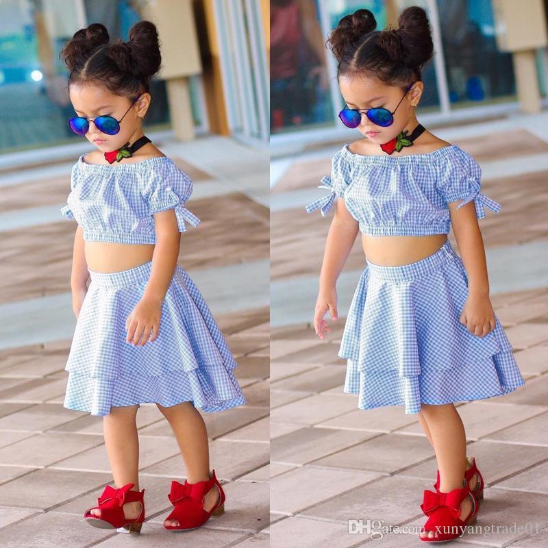 아기 의류 여자 복장 달콤한 2PCS 세트 INS 여름 패션 블루 격자 무늬 바지 주머니 퍼프 소매 탑스 치마 세트 어린이 의류 226 세트