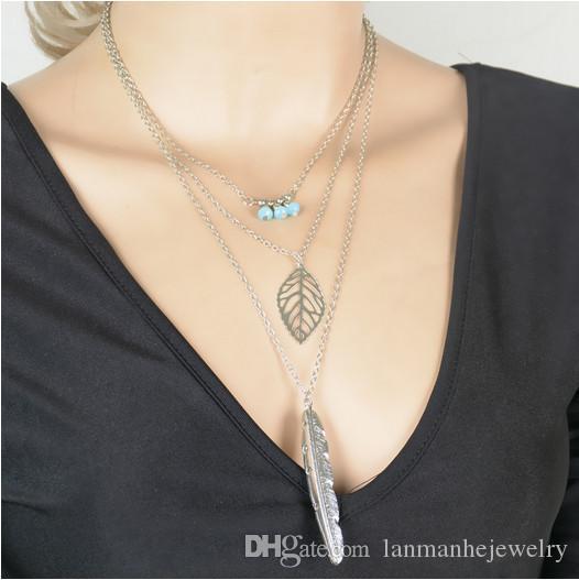 Ожерелья с подвесками Бижутерия Урожай Модные синие бусы Позолоченные / посеребренные выдолбленные перья из легкого листа 3-слойные ключичные ожерелья SN817