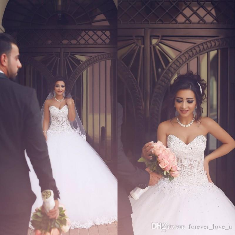 2019 Arabo Abiti da ballo Abiti da sposa Illusion Corpetto di perline Cristalli Appliques di pizzo Puffy Tulle Lunghezza del pavimento Principessa Abiti da sposa