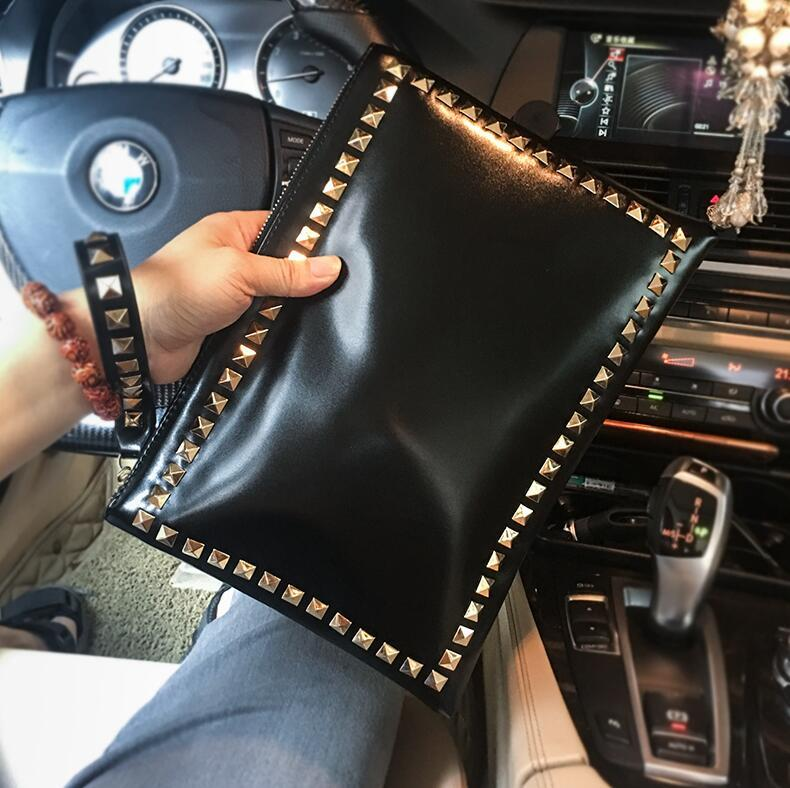 Wholesale brand men hand bag fashion rivet envelope bag personality rivet punk wrist bag leisure large capacity leather storage wallet