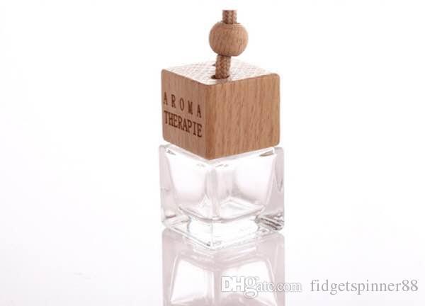 O envio gratuito de alta qualidade 5ml transparente Pingente Car Perfumes frasco frascos Praça difusor com Cap de madeira