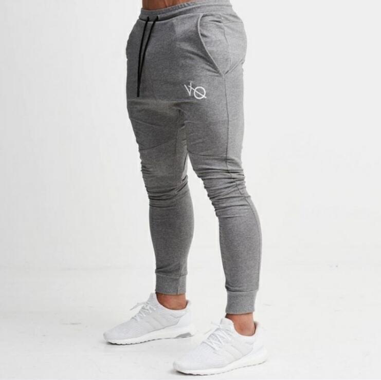2018 Осень Новый Sweatpants Мужчины Твердые тренировки Бодибилдинг Одежда Повседневная Фитнес Joggers Брюки Тощие брюки