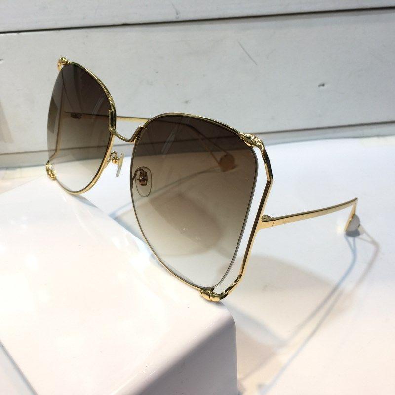 0252 Gafas de sol para las mujeres Estilo popular Big Hollow Frame Summer Style Top Quality UV Protection Lens Modelo de moda Calidad superior con caso