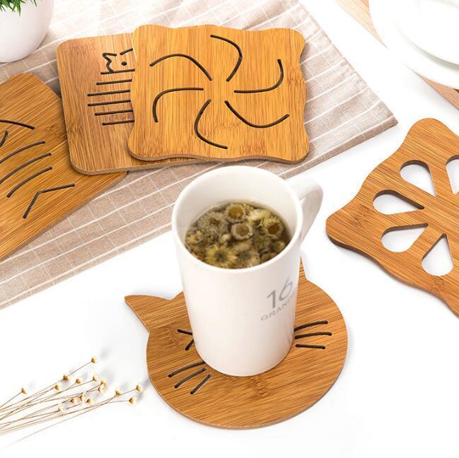 Resistente ao calor almofada de madeira panela panela mat titular cozinha cozinhar isolamento oco desenhos animados pad taça copo coasters enfeites de mesa