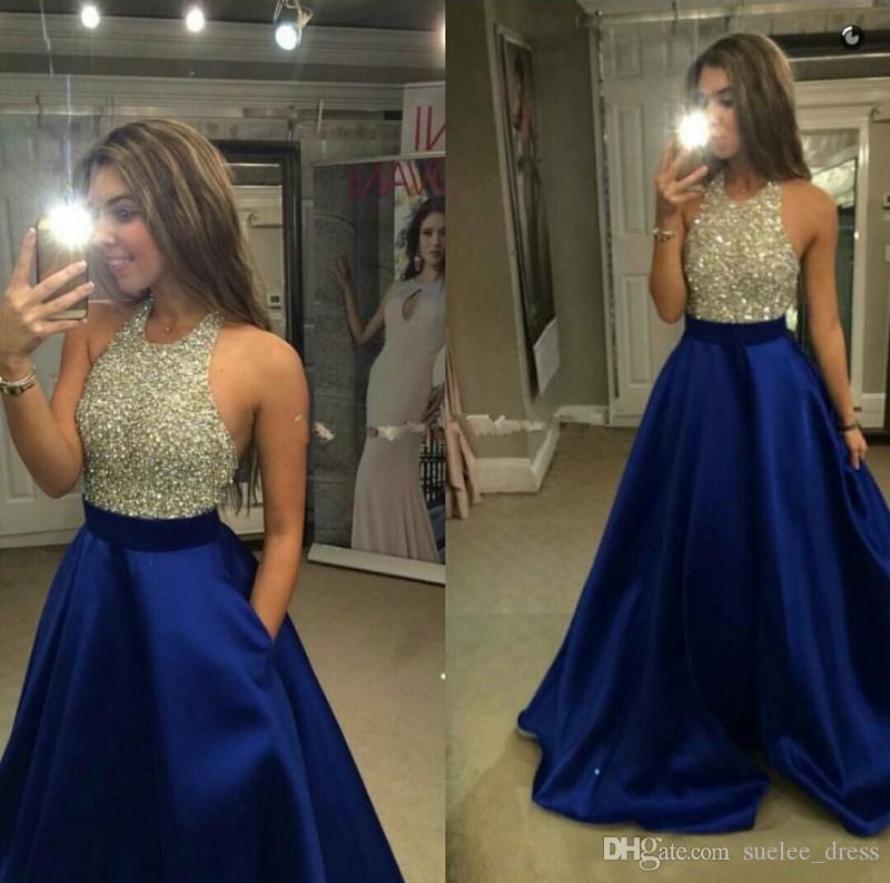 2018 più recente Royal Blue Prom Dresses argento paillettes perline Halter senza maniche con tasche Sweep treno formale usura occasione abito da sera