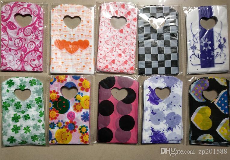 200pcs / lot 15X9cm sacchetti di gioielli cuore fiori modelli sacchetto di plastica sacchetti di gioielli sacchetti di stile misto imballaggio degli accessori