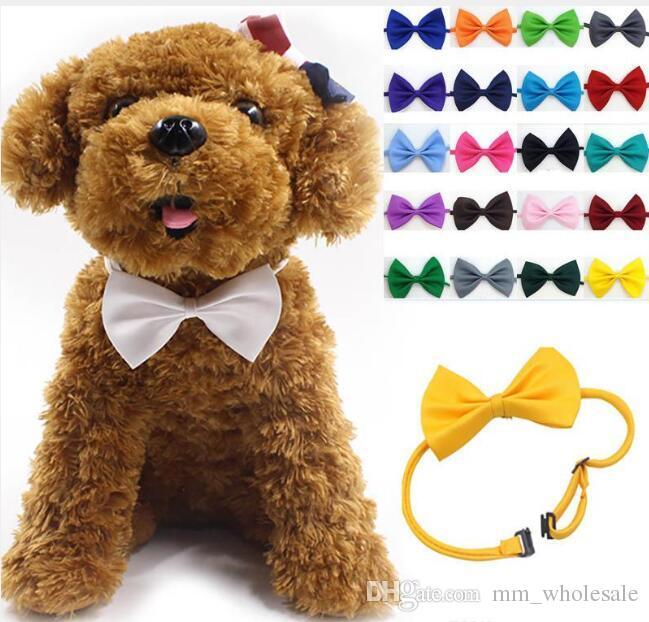 도매 100pcs / lot 애완 동물 머리 장식 개 목 개 넥타이 개 나비 넥타이 고양이 넥타이 애완 용품 미용 용품 여러 가지 빛깔의