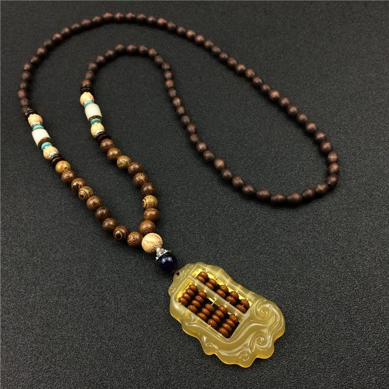 Un ábaco suena una cadena de suéter colgante de dos dioses del operador de oro hombres y mujeres largo collar decorativo