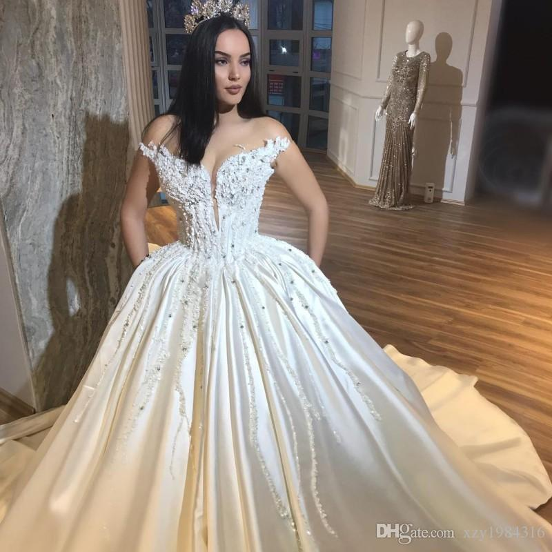 Dubai Princess A-Line Wedding Dress See Through Jewel Neck Pearls Beaded Applique Bridal Dresses Elegant Satin Sweep Train Wedding Gowns
