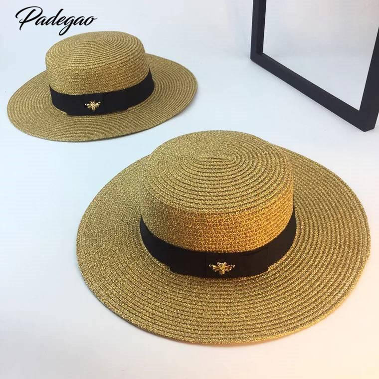 Primavera y verano nuevo retro dorado trenzado cabeza plana sombrero de paja dama amplia aleros protector solar sombrero de verano gorra S18101708