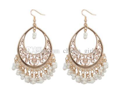 new Europe and the United States new hot sell Bohemian hollowed-out rice beads fringe trend earrings jewelry