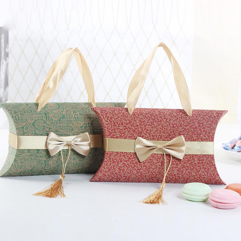 Коробка конфеты формы подушки с коробками подарка ручки Bowknot для благосклонности свадебного банкета