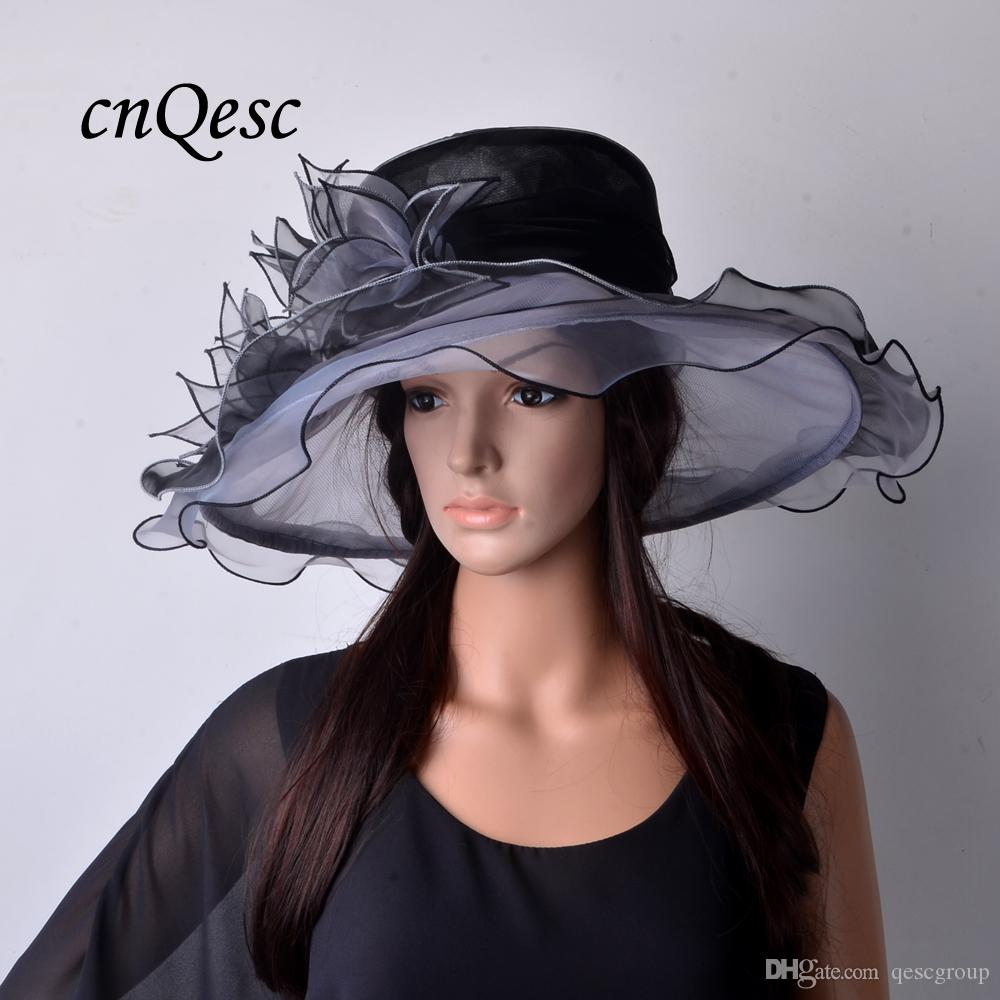 NEW SILVER/BLACK ORGANZA HAT/BRIDAL HAT WITH LEAVES FLOWERS .IDEAL FOR KENTYCKY DERBY AND WEDDING.