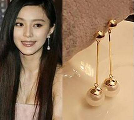 Stud Pendientes al por mayor para mujeres The New Korean Fashion Jewelry OL temperamento larga sección de Pendientes de perlas Imitación chapado en oro Pendientes