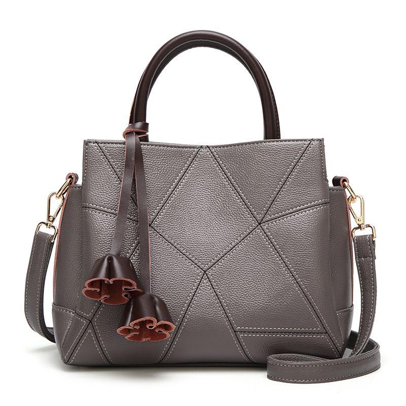 Stilvolle Handtasche 2018 100 Runde Markenfrauen Beutel der Schulter schiefer Kreuz Beutel der Frauen