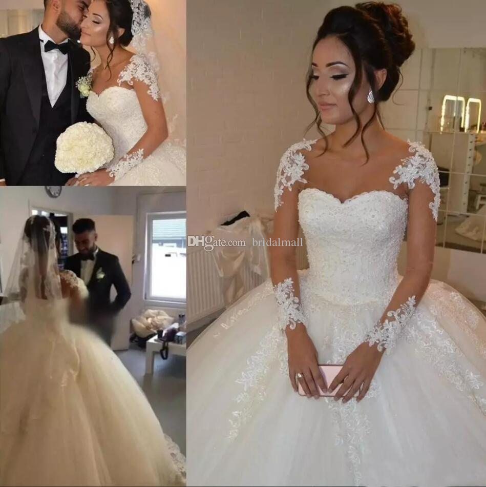 Más el tamaño 2020 Sheer manga larga vestido De bola vestidos De novia De encaje africano Vestido De novia con cuentas perlas una línea De vestidos De novia Vestido De Noiva