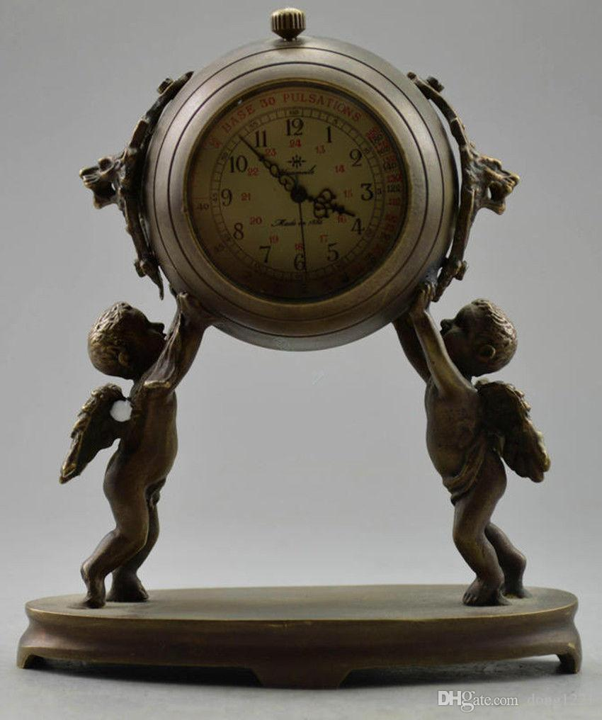 Collectible Decorated Old Brass Carved Angel child Mechanical Table Clock